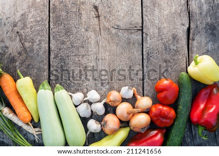 Fresh vegetables on vintage wooden background with copy-space - stock photo