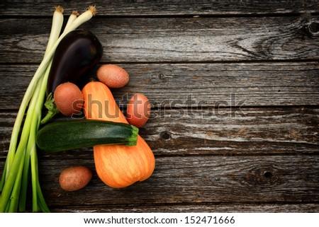 Fresh vegetables on wood background - stock photo