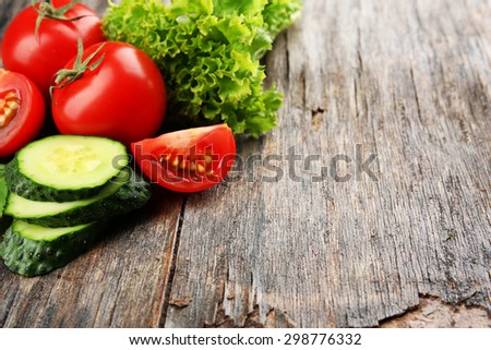 Fresh vegetables on wooden background - stock photo