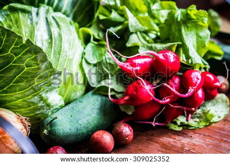 Fresh vegetables on wooden background - stock photo