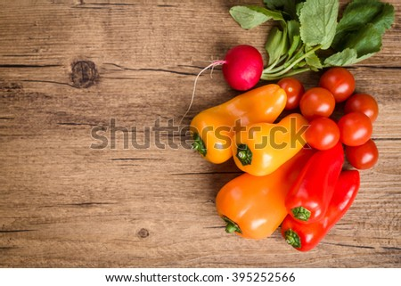 Fresh vegetables on wooden background. Ingredients for vegetable salad. Flat lay, top view  - stock photo
