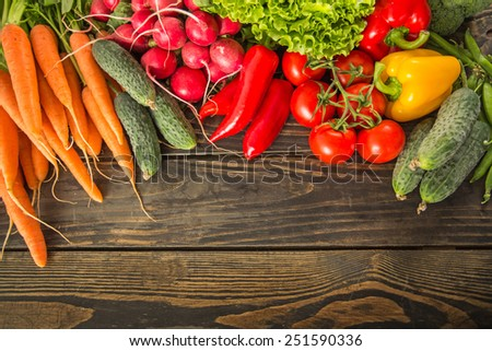 Fresh vegetables on wooden table - stock photo