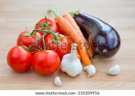 Fresh vegetables organic food set still life with eggplant, carrot, garlic and tomato - stock photo