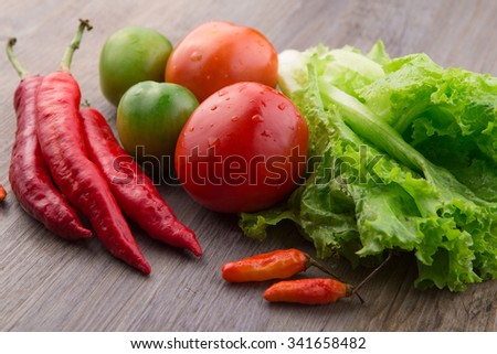 Fresh vegetables: red chilli, birds eye chilli, lettuce, red tomato and green tomato
