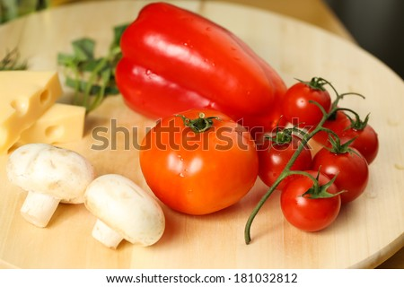 Fresh vegetables: red pepper, tomatoes, mushrooms and cheese - stock photo