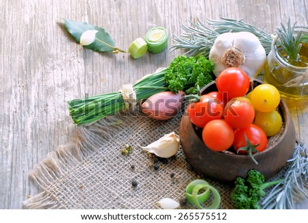 fresh vegetables, spices and aromatic herbs on a wooden background with copy space - stock photo