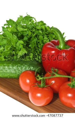 Fresh vegetables: sweet pepper, branch of tomatoes, cucumber and parsley