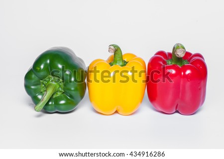 Fresh vegetables Three sweet Red, Yellow, Green Peppers isolated - stock photo