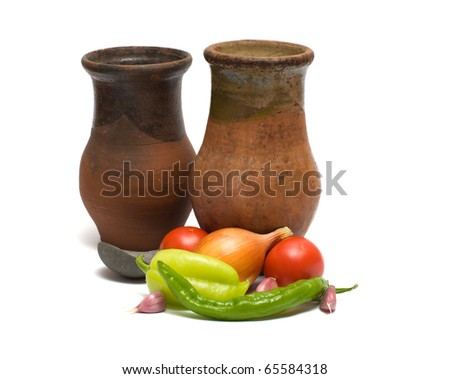 Fresh vegetables two ceramic bowls and pewter spoon on a white background. - stock photo