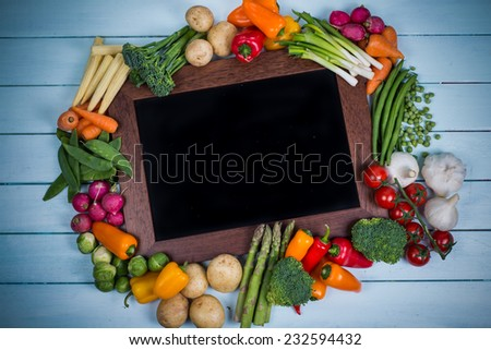 fresh vegetables with chalk board - stock photo