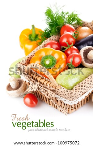 fresh vegetables with leaves in the basket isolated on white background - stock photo