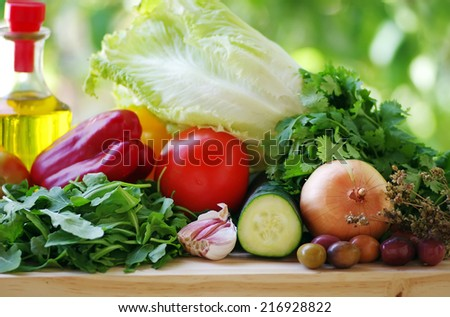 fresh vegetables with olive oil  - stock photo