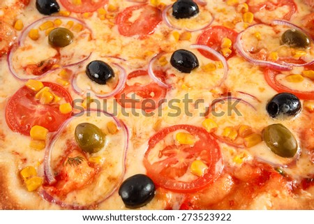 Fresh Vegetarian pizza from Italy with tomatoes, corn, onion, green and black olives close-up, selective focus, macro - stock photo