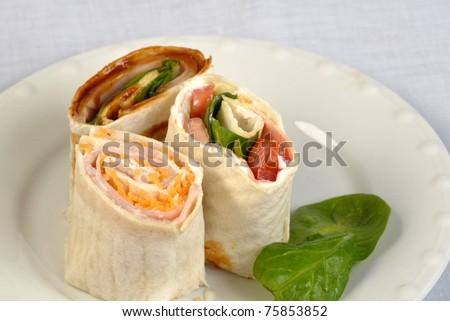 Fresh veggie wraps on a plate - stock photo