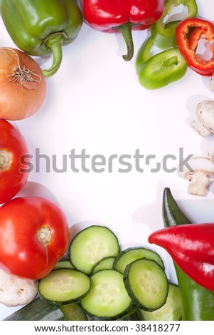 Fresh veggies on clean white table top with space for your text - stock photo