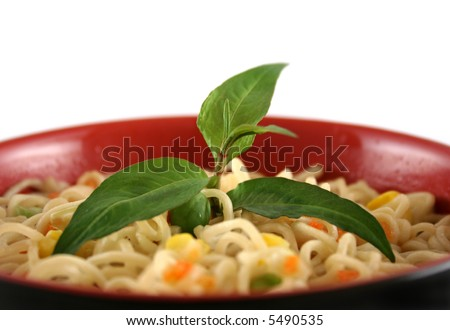 Fresh Vietnamese mint with a bowl of noodles. - stock photo