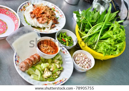 Fresh Vietnamese style food set , Grilled pork with vegetables and wrapping flour