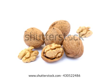 Fresh walnuts with a shell isolated on white background - stock photo
