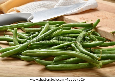 Fresh washed organic green beans on a cutting board - stock photo