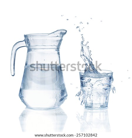 Fresh water glass with splash and bottle isolated on a white background - stock photo