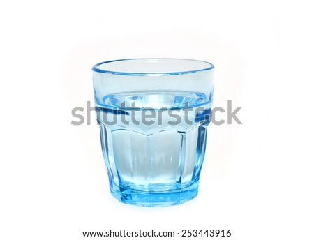 fresh water in a a blue glass, fresh glass of water - stock photo
