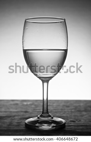 fresh water in glass with dark tone.