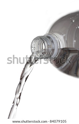 Fresh water pouring from  plastic bottle isolated on white - stock photo