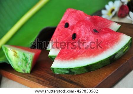 Fresh watermelon sliced on wooden board - stock photo