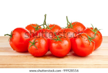 Fresh wet tomatoes on a cutting board wooden Isolated on white background