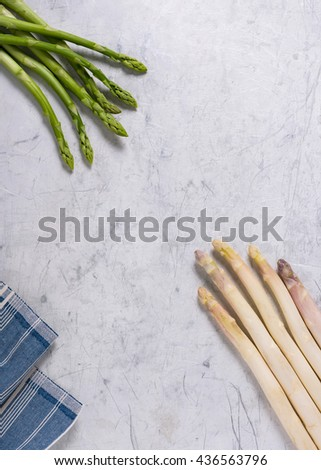 Fresh white and green asparagus on an old oven baking tray. Delicious, healthy ingredient. Empty copy space for text. - stock photo