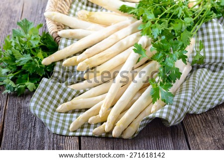 Fresh white asparagus of Germany - Bavaria on a wooden table - stock photo