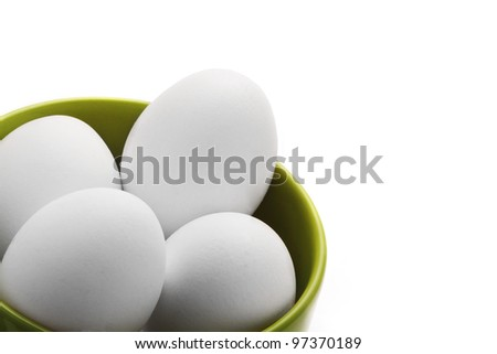 Fresh white cage free eggs on white background with copy space. - stock photo