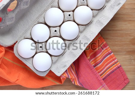 Fresh white eggs in crate - stock photo