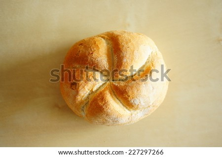 Fresh whole bread on wooden background - stock photo