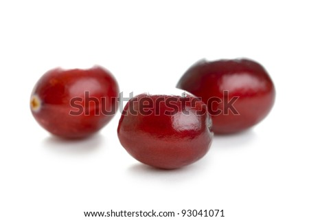 fresh whole cranberries isolated on a white background