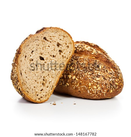Fresh whole grain bread cut in half on white background - stock photo
