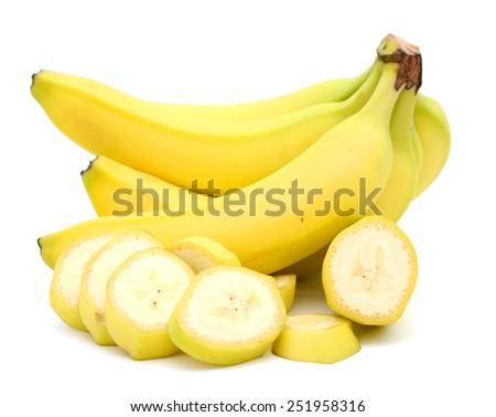 fresh yellow bananas and slices on white background - stock photo