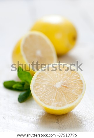 fresh yellow lemon on table - stock photo