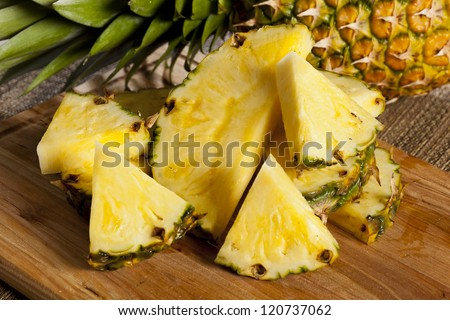 Fresh Yellow Organic Pineapple cut into slices - stock photo