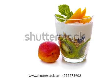 Fresh Yogurt with kiwi and Apricot  isolated on brown cloth background.