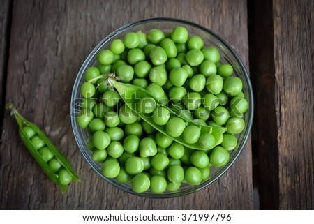 Fresh, young green peas  - stock photo
