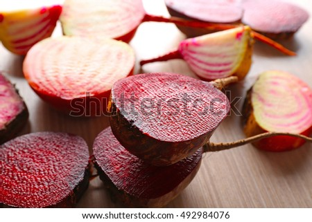 Fresh young sliced beets on wooden table