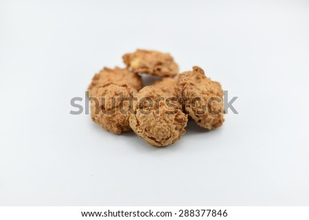 Fresh yummy & tasty homemade cookies isolated on white backdrop with lot of space for advertisement text - stock photo