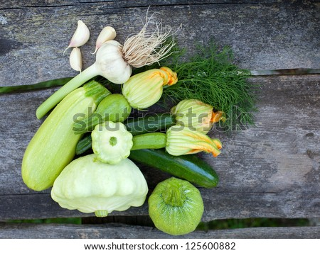 fresh zucchini fruits on wooden table - stock photo