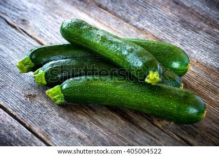 Fresh zucchini on wooden background - stock photo