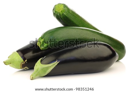 fresh zucchini's and eggplant on a white background - stock photo