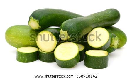 Fresh zucchini with slices on white - stock photo