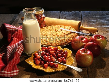 Freshly baked apple crisp and cranberry pie - stock photo