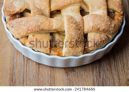freshly baked apple pie in a wooden background - stock photo