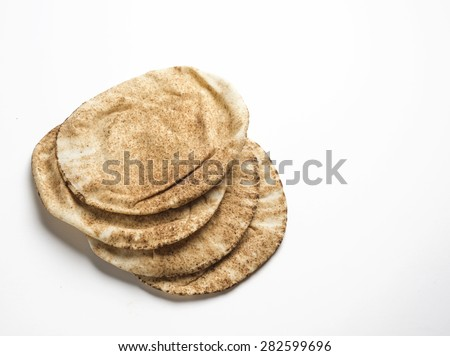Freshly baked arabic flat bread called kuboos. - stock photo